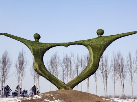 Statue of People Holding Hands in Heart Shape